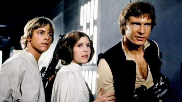 Mark Hamill, left, with Carrie Fisher and Harrison Ford in the original Star Wars film.