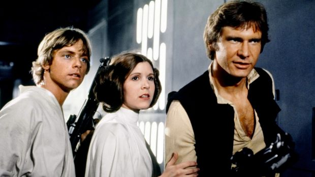 Mark Hamill, left, with Carrie Fisher and Harrison Ford in the original <i>Star Wars</i> film.