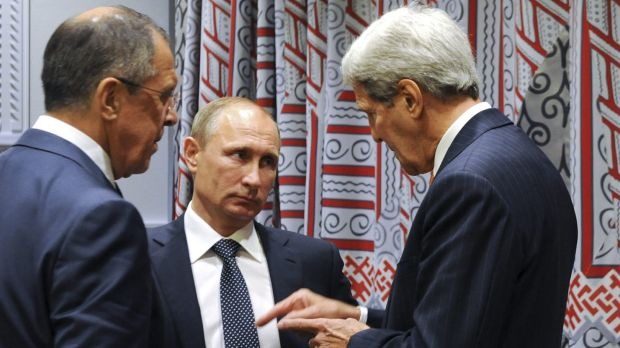 Russian President Vladimir Putin (centre) and Foreign Minister Sergey Lavrov, listen to US Secretary of State John Kerry ...
