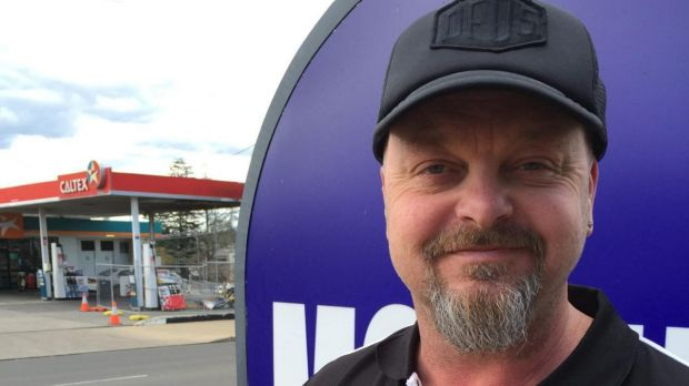 Ivan Smith, manager of the Abbotsleigh Motor Inn, rescued an elderly motorist whose car crashed into a petrol bowser in ...