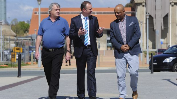 Signed up: Chief Minister Andrew Barr talks with future Uber drivers Gary Woodbridge and Teferi Gungl.