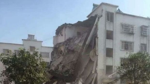 The remains of a government building destroyed by a suspected parcel bomb in Liucheng County, southern China. It was one ...