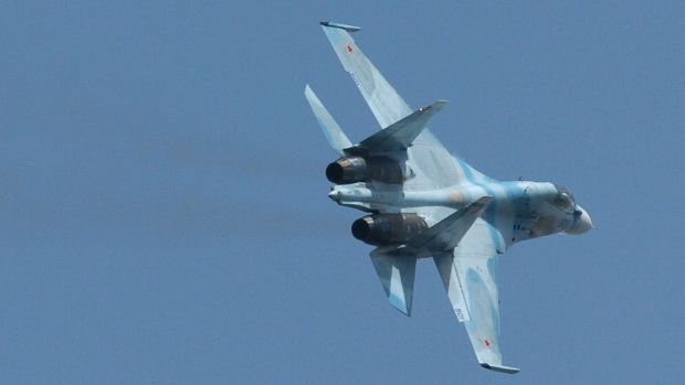 A Russian Sukhoi SU-30 fighter. In recent weeks, Russia has deployed more than two dozen fighter aircraft, attack ...