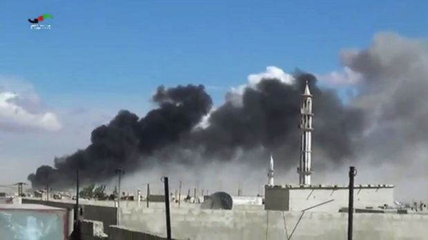 Smoke rises after airstrikes by military jets in Talbiseh in the Homs province, western Syria, after Russian military ...