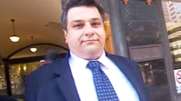 Ice dealing solicitor Nicholas Gouliaditis coming out of the Downing Centre court.
