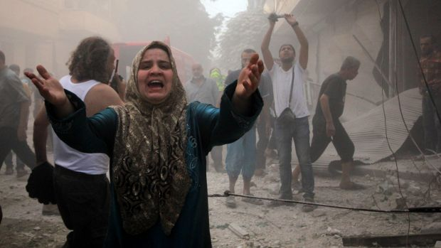 A Syrian woman mourns following an air strike by Assad government forces on the al-Mowasalat neighbourhood of the ...
