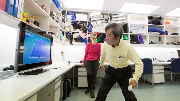 Dr Penelope McNulty with stroke patient Si Saegusa, who is using a Nintendo Wii for rehabilitation.