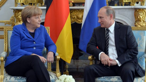 German Chancellor Angela Merkel and Russian President Vladimir Putin talk in Paris last year.
