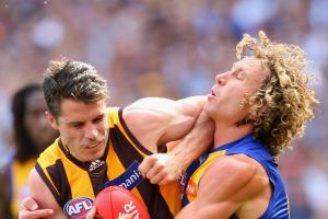 MELBOURNE, AUSTRALIA - OCTOBER 03: Isaac Smith of the Hawks is tackled by Matt Priddis of the Eagles  during the 2015 ...