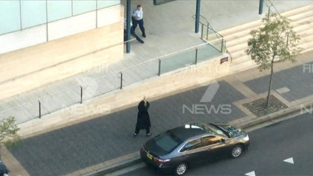 Extreme beliefs ... Fifteen-year-old Farhad Jabar points his gun at a officer during his attack on Parramatta police ...