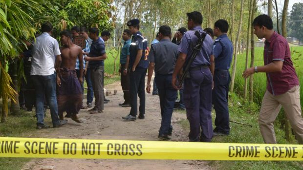 Bangladeshi security officers stand by the site where a Japanese Kunio Hoshi was killed at Mahiganj village in Rangpur ...