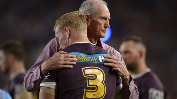 """""""I love being their coach"""": Wayne Bennett consoles Jack Reed after the grand final loss to the Cowboys."""