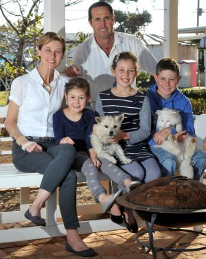 Geoff and Kim Hunt with their children Phoebe (left), Mia and Fletcher.