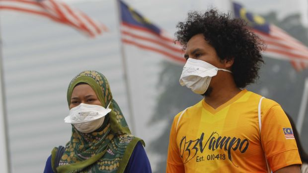 A Malaysian in a face mask on Sunday, as the haze from forest fires worsens across south-east Asia.