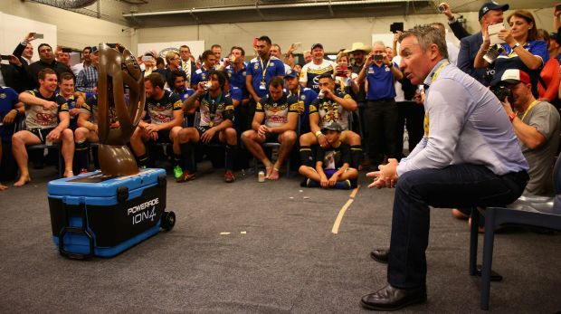 Job done: Cowboys coach Paul Green talks to his players after the 2015 grand final.