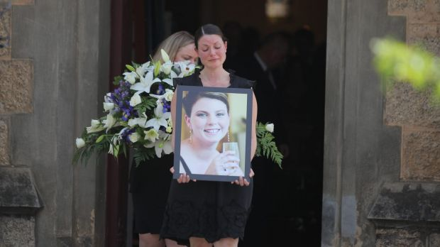 Mourners leave the Beechworth church where Andrea Lehane was farewelled, and where she married her husband, James, five ...
