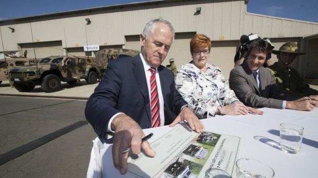 """I'm not going to drive it in to Melbourne"": Prime Minister Malcolm Turnbull and Defence Minister Marise Payne inspect ..."