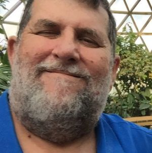 Brisbane cab company owner Greg Collins, a 30-year taxi industry veteran who admitted in a social media post to bashing ...