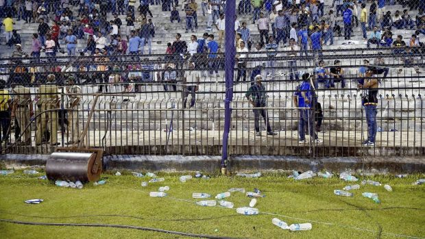 Trouble: Water bottles thrown by spectators lie on the ground during the T20 match between India and South Africa.