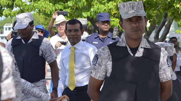 Facing 13 years in prison ... Former  Maldives president Mohamed Nasheed, centre,  after appearing at the High Court in ...