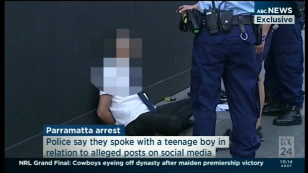 Police arrest a student outside Arthur Phillip High School.