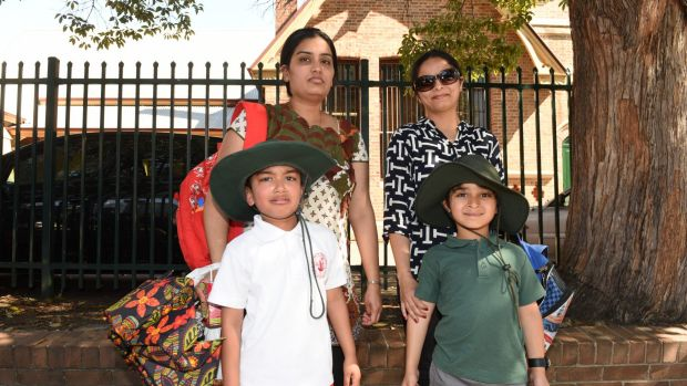 Mothers Deephi Devineni and Shaheen Lalani with their sons who attend Parramatta Public School.