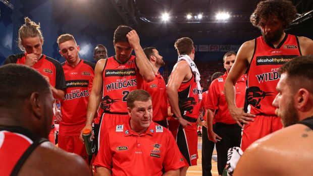 28 Mar 2014 PERTH, AUSTRALIA - MARCH 28: Trevor Gleeson, coach of the Wildcats addresses his players at a time-out ...