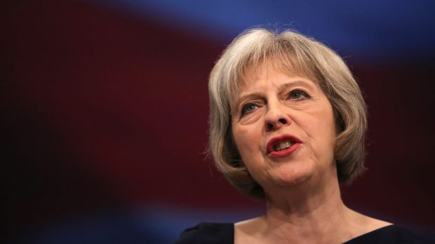 British Home Secretary Theresa May delivers her keynote speech to delegates during the Conservative Party conference on ...