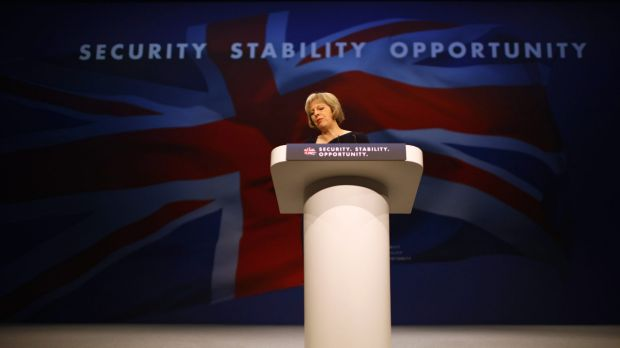 "Mrs May told the conference it is ""impossible to build a cohesive society"" if immigration was too high and that Britain ..."