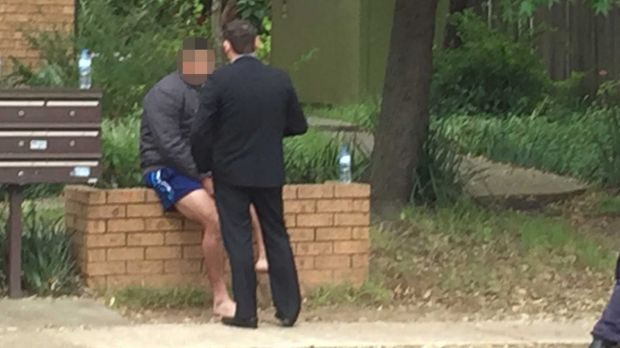 Police raids: The scene outside a house at Lane Street, Wentworthville.