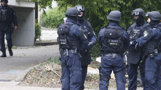 Police search a house in Sydney's west.