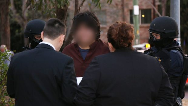 A man is arrested in Wentworthville on Wednesday.