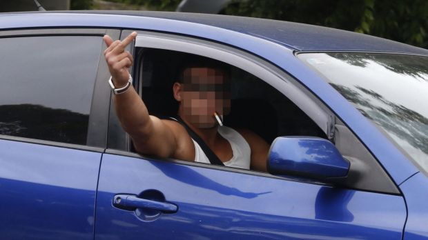 A man in Wentworthville gestures to the media on Wednesday.