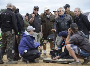 On set: Director George Miller and crew during filming at Penrith Lakes.