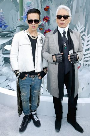 G-Dragon and fashion designer Karl Lagerfeld after the Chanel show at  Paris Fashion Week earlier this year.