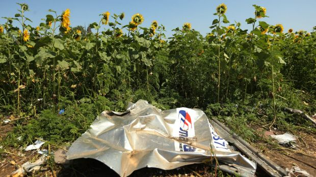 A piece of plane debris at one of the sites where the front section of Malaysian flight MH17 crashed and the pilots' ...