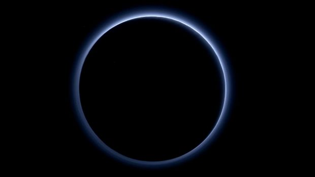 The blue-tinged atmosphere of Pluto as taken by the New Horizon probe.