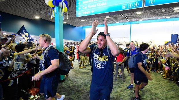 Highs and lows: Cowboys star Jason Taumalolo waves to the crowd after arriving back in Townsville after the grand final.