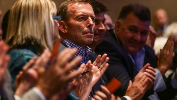 Former prime minister Tony Abbott observed from his front-row seat while several hundred members in the rows behind had ...