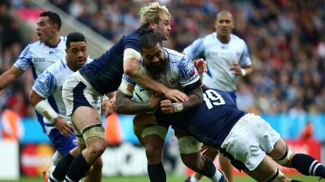 Faifili Levave of Samoa is tackled by Johnny Grey and Tim Swinton.