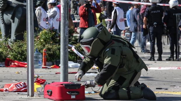 A Turkish bomb disposal expert investigates a suitcase at the scene of a blast during a peace rally in Ankara in October.