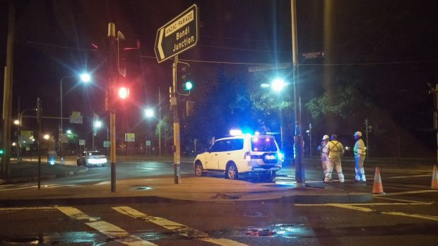Police investigating at the scene of the accident on Anzac Parade, Moore Park.