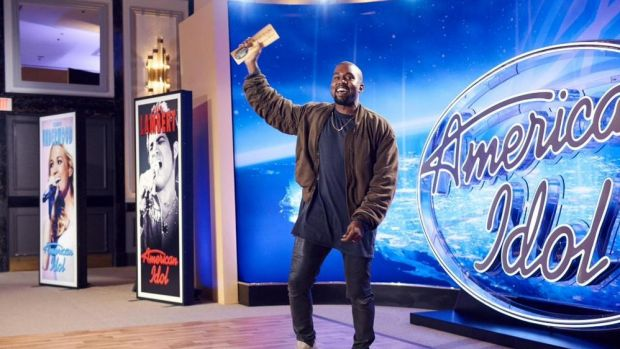 Kanye West with his 'ticket to Hollywood' after auditioning on <i>American Idol</i>.