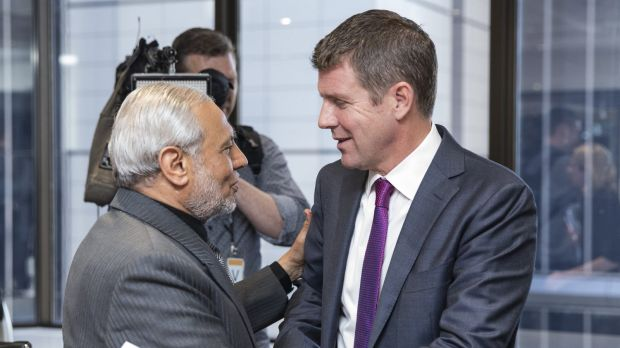 Mike Baird is greeted by Grand Mufti of Australia Dr Ibrahim Abu Mohammed at a meeting with Muslim community leaders to ...