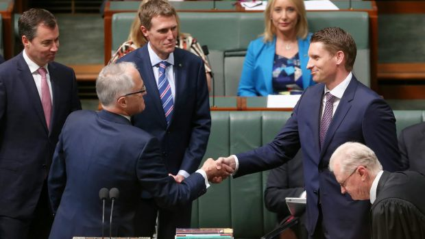 The newly elected member for Canning, Andrew Hastie, is congratulated by Prime Minister Malcolm Turnbull after being ...