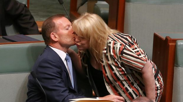 Former prime minister Tony Abbott is greeted by colleague Natasha Griggs as they take their seats on the backbench for ...