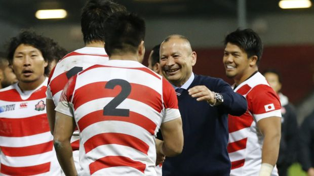 All smiles: Japan coach Eddie Jones talks with his players after the Rugby World Cup pool-B match between the US and Japan.