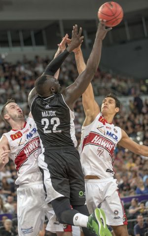 Muscling up: Melbourne's Majok Majok goes up against Illawarra tall timber AJ Ogilvy and Oscar Forman.
