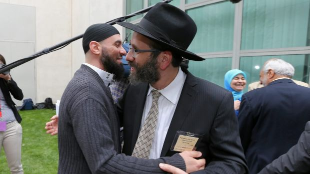 Sheikh Wesam Charkawi and Rabbi Zalman Kastel greet each other at the event.