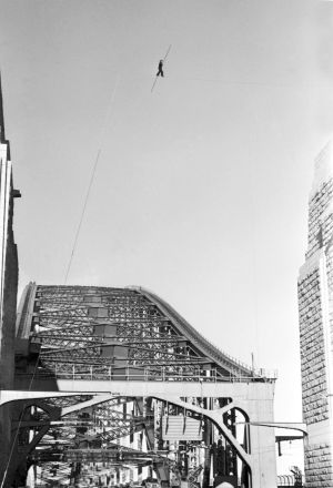 Stopping traffic: Petit walks between the two pylons of the northern side of the Sydney Harbour Bridge in 1973.